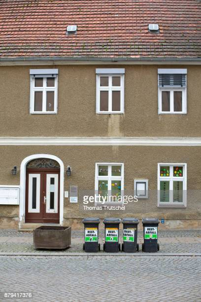 Dustbins with the words 'residual waste' are standing in front of a house on November 19 2017 in Luebben Germany