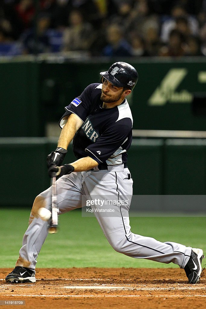 <a gi-track='captionPersonalityLinkClicked' href=/galleries/search?phrase=Dustin+Ackley&family=editorial&specificpeople=4352278 ng-click='$event.stopPropagation()'>Dustin Ackley</a> of Seattle Mariners hit a triple in the top half of the third inning during the pre season game between Yomiuri Giants and Seattle Mariners at Tokyo Dome on March 26, 2012 in Tokyo, Japan.