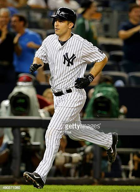Dustin Ackley of the New York Yankees heads for home after he hit a two run home run in the first inning against the Boston Red Sox on September 29...