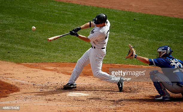 Dustin Ackley of the New York Yankees hits a two run home run in the fourth inning against the Toronto Blue Jays at Yankee Stadium on September 13...