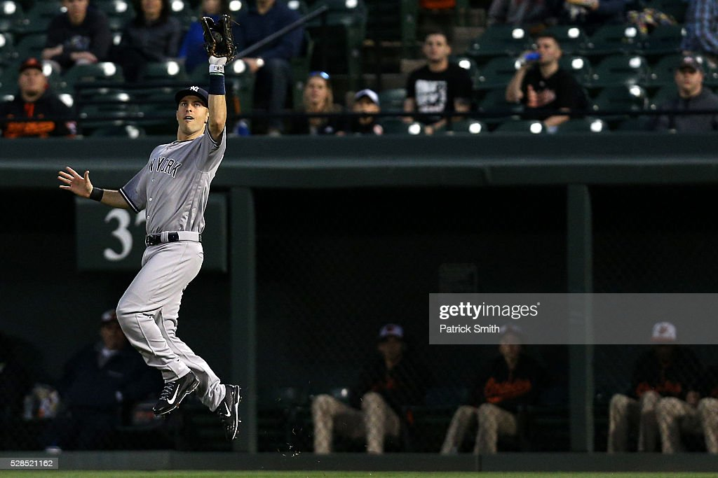 <a gi-track='captionPersonalityLinkClicked' href=/galleries/search?phrase=Dustin+Ackley&family=editorial&specificpeople=4352278 ng-click='$event.stopPropagation()'>Dustin Ackley</a> #29 of the New York Yankees makes a catch on Manny Machado #13 of the Baltimore Orioles (not pictured) in the third inning at Oriole Park at Camden Yards on May 5, 2016 in Baltimore, Maryland.