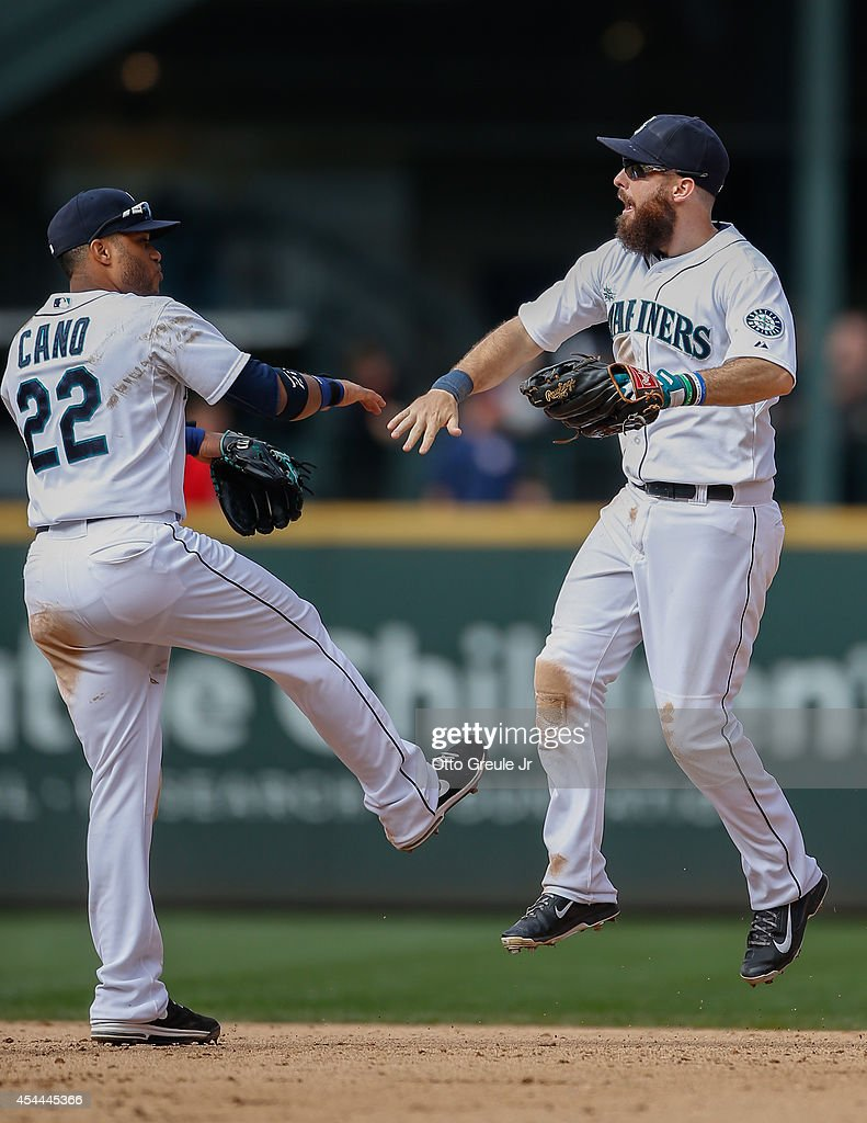 <a gi-track='captionPersonalityLinkClicked' href=/galleries/search?phrase=Dustin+Ackley&family=editorial&specificpeople=4352278 ng-click='$event.stopPropagation()'>Dustin Ackley</a> #13 of the Seattle Mariners celebrates with <a gi-track='captionPersonalityLinkClicked' href=/galleries/search?phrase=Robinson+Cano&family=editorial&specificpeople=538362 ng-click='$event.stopPropagation()'>Robinson Cano</a> #22 after a 5-3 win over the Washington Nationals at Safeco Field on August 31, 2014 in Seattle, Washington.