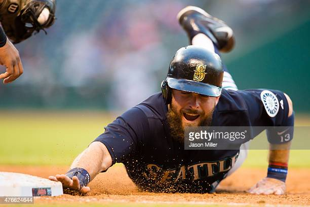 Dustin Ackley of the Seattle Mariners dives back to first base on a pickoff attempt during the fourth inning against the Cleveland Indians at...