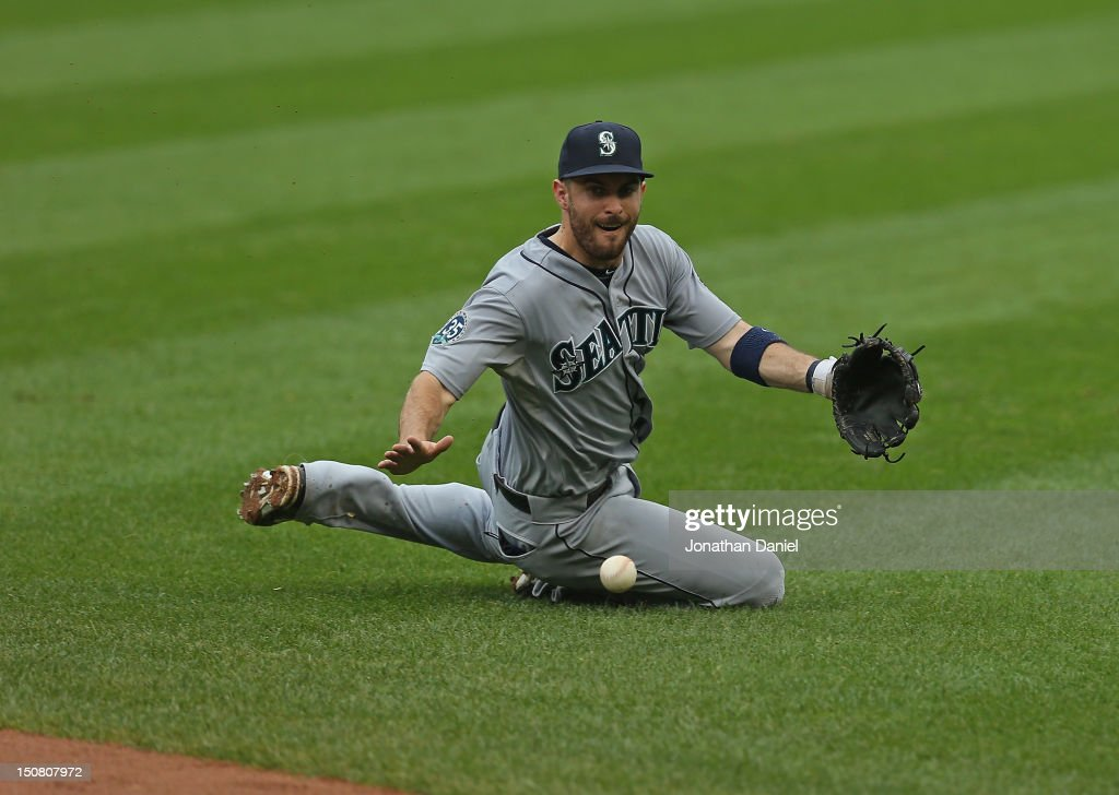 <a gi-track='captionPersonalityLinkClicked' href=/galleries/search?phrase=Dustin+Ackley&family=editorial&specificpeople=4352278 ng-click='$event.stopPropagation()'>Dustin Ackley</a> #13 of the Seattle Mariners dives to try and make a play on a ball hit by Ray Olmedo of the Chicago White Sox at U.S. Cellular Field on August 26, 2012 in Chicago, Illinois.