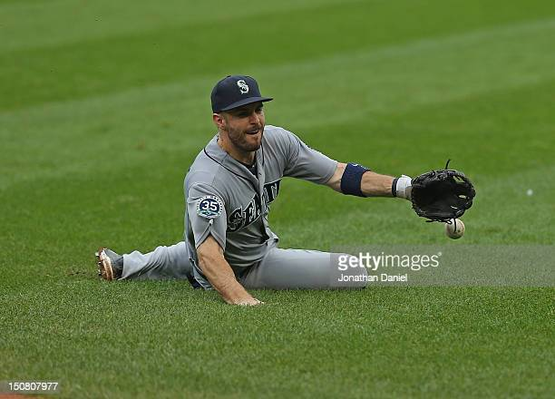 Dustin Ackley of the Seattle Mariners dives to try and make a play on a ball hit by Ray Olmedo of the Chicago White Sox at US Cellular Field on...