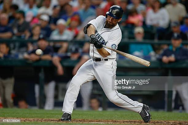 Dustin Ackley of the Seattle Mariners flies out to center in the seventh inning against the Kansas City Royals at Safeco Field on June 23 2015 in...
