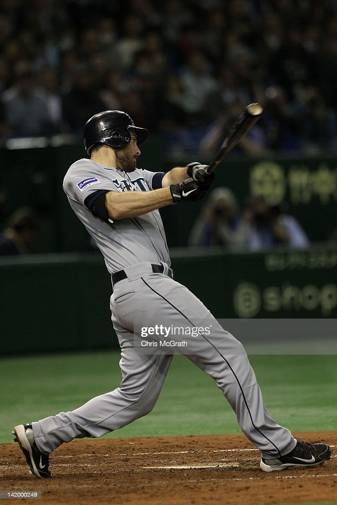 <a gi-track='captionPersonalityLinkClicked' href=/galleries/search?phrase=Dustin+Ackley&family=editorial&specificpeople=4352278 ng-click='$event.stopPropagation()'>Dustin Ackley</a> #13 of the Seattle Mariners hits a single to get home team mate Brendan Ryan #26 in the 11th inning against the Oakland Athletics during the MLB Opening Series game between the Seattle Mariners and Oakland Athletics at Tokyo Dome on March 28, 2012 in Tokyo, Japan.