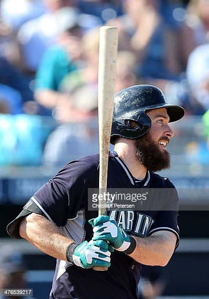 Dustin Ackley of the Seattle Mariners hits a three RBI double against the Colorado Rockies during the fifth inning of the spring training game at...