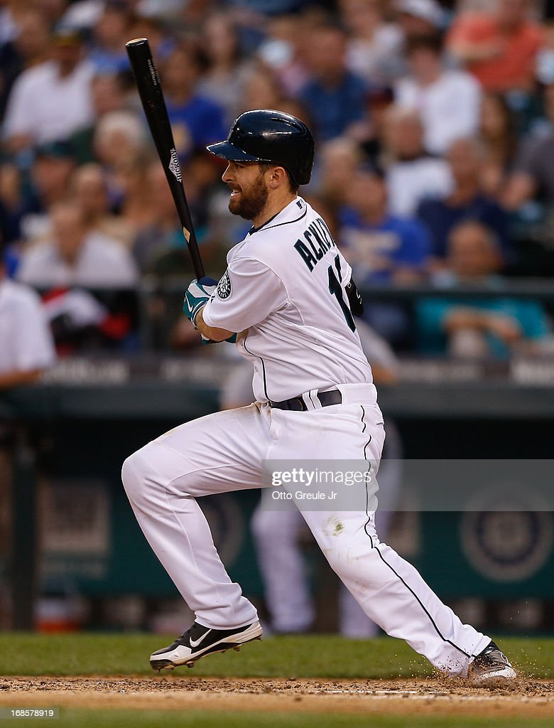 <a gi-track='captionPersonalityLinkClicked' href=/galleries/search?phrase=Dustin+Ackley&family=editorial&specificpeople=4352278 ng-click='$event.stopPropagation()'>Dustin Ackley</a> #13 of the Seattle Mariners hits an RBI single in the seventh inning against the Oakland Athletics at Safeco Field on May 11, 2013 in Seattle, Washington.