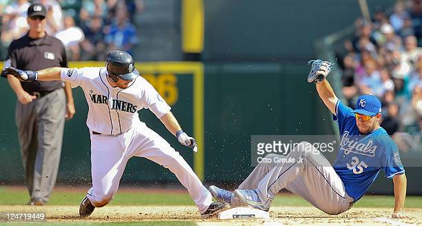 Dustin Ackley of the Seattle Mariners is doubled off of first on a ball hit by Mike Carp as first baseman Eric Hosmer of the Kansas City Royals...