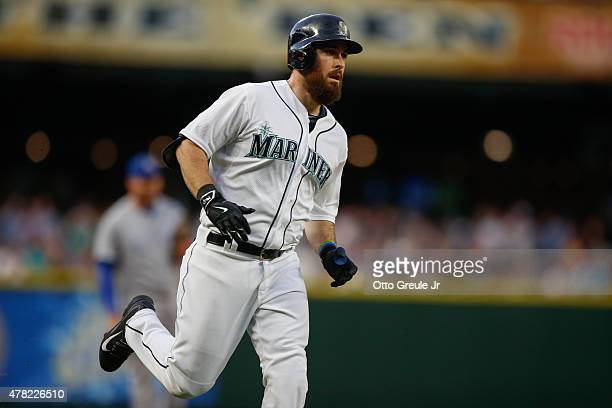 Dustin Ackley of the Seattle Mariners rounds the bases after hitting a tworun homer against the Kansas City Royals in the fifth inning at Safeco...
