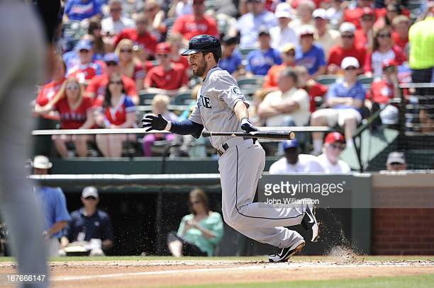 Dustin Ackley of the Seattle Mariners sacrifice bunts as he bats against the Texas Rangers at Rangers Ballpark on April 21 2013 in Arlington Texas...