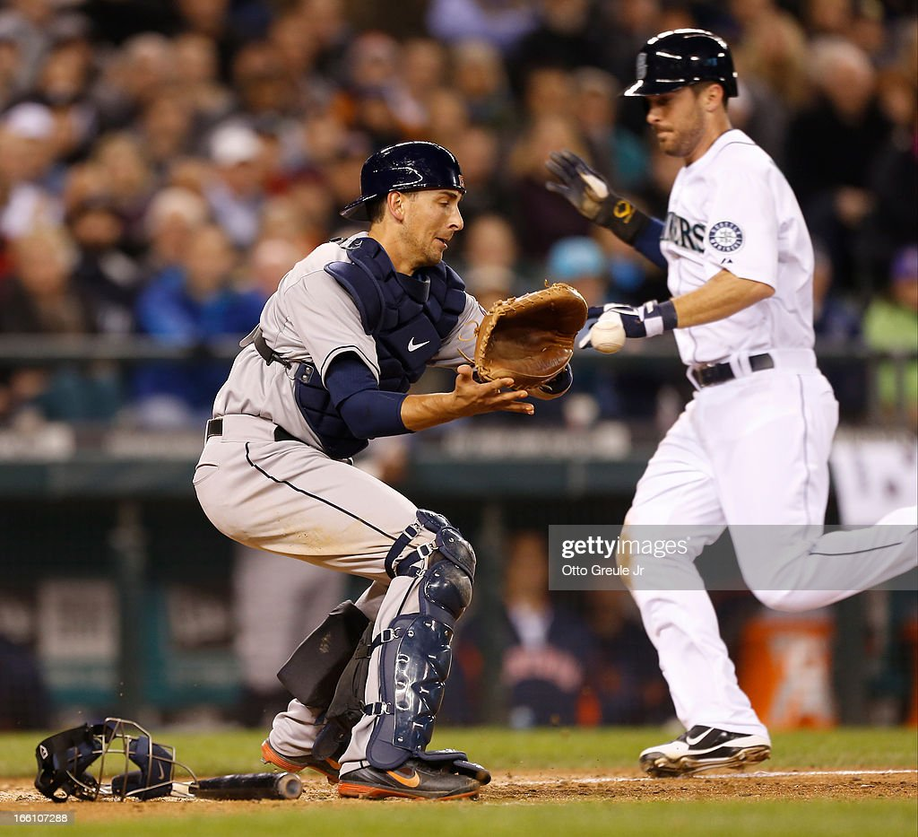 <a gi-track='captionPersonalityLinkClicked' href=/galleries/search?phrase=Dustin+Ackley&family=editorial&specificpeople=4352278 ng-click='$event.stopPropagation()'>Dustin Ackley</a> #13 of the Seattle Mariners scores on a sacrifice bunt by Franklin Gutierrez in the fifth against Jason Castro #15 of the Houston Astros on Opening Day at Safeco Field on April 8, 2013 in Seattle, Washington.