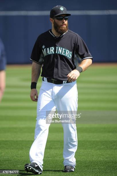 Dustin Ackley of the Seattle Mariners warms up before the game against the San Diego Padres at Peoria Stadium on February 27 2014 in Peoria Arizona