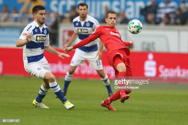 Dustin Bomheuer of Duisburg challenges Dominik Drexler of Kiel during the Second Bundesliga match between MSV Duisburg and Holstein Kiel at...