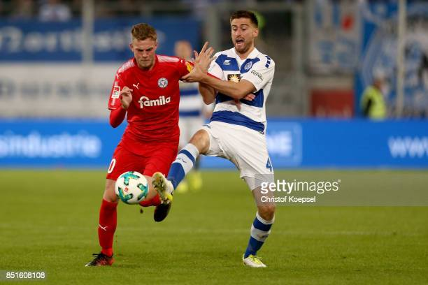 Dustin Bomheuer of Duisburg challenges Marvin Ducksch of Kiel during the Second Bundesliga match between MSV Duisburg and Holstein Kiel at...