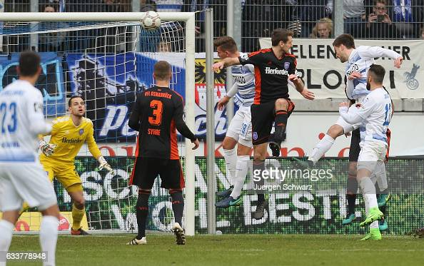 Dustin Bomheur of Duisburg heads to score the first goal for his team during the third league match between MSV Duisburg and VfL Osnabrueck at...