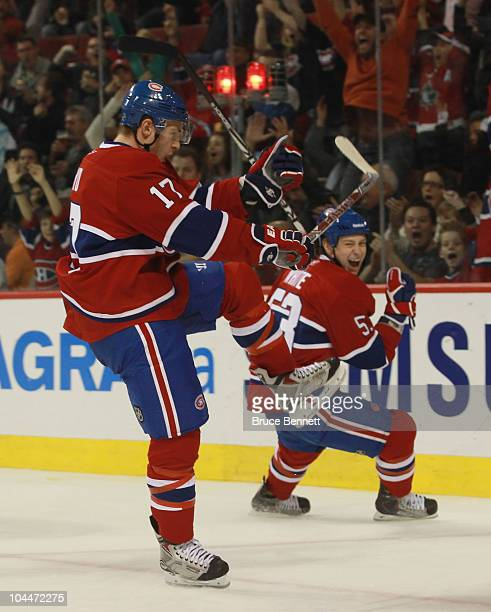 Dustin Boyd of the Montreal Canadiens scores at 657 of the second period against the Minnesota Wild while teammate Ryan White celebrates in the...