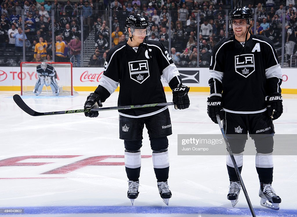 <a gi-track='captionPersonalityLinkClicked' href=/galleries/search?phrase=Dustin+Brown+-+Ice+Hockey+Player&family=editorial&specificpeople=4175092 ng-click='$event.stopPropagation()'>Dustin Brown</a> #23 and <a gi-track='captionPersonalityLinkClicked' href=/galleries/search?phrase=Anze+Kopitar&family=editorial&specificpeople=634911 ng-click='$event.stopPropagation()'>Anze Kopitar</a> #11 of the Los Angeles Kings smile during the national anthem before the game against the Vancouver Canucks at STAPLES Center on October 13, 2015 in Los Angeles, California.