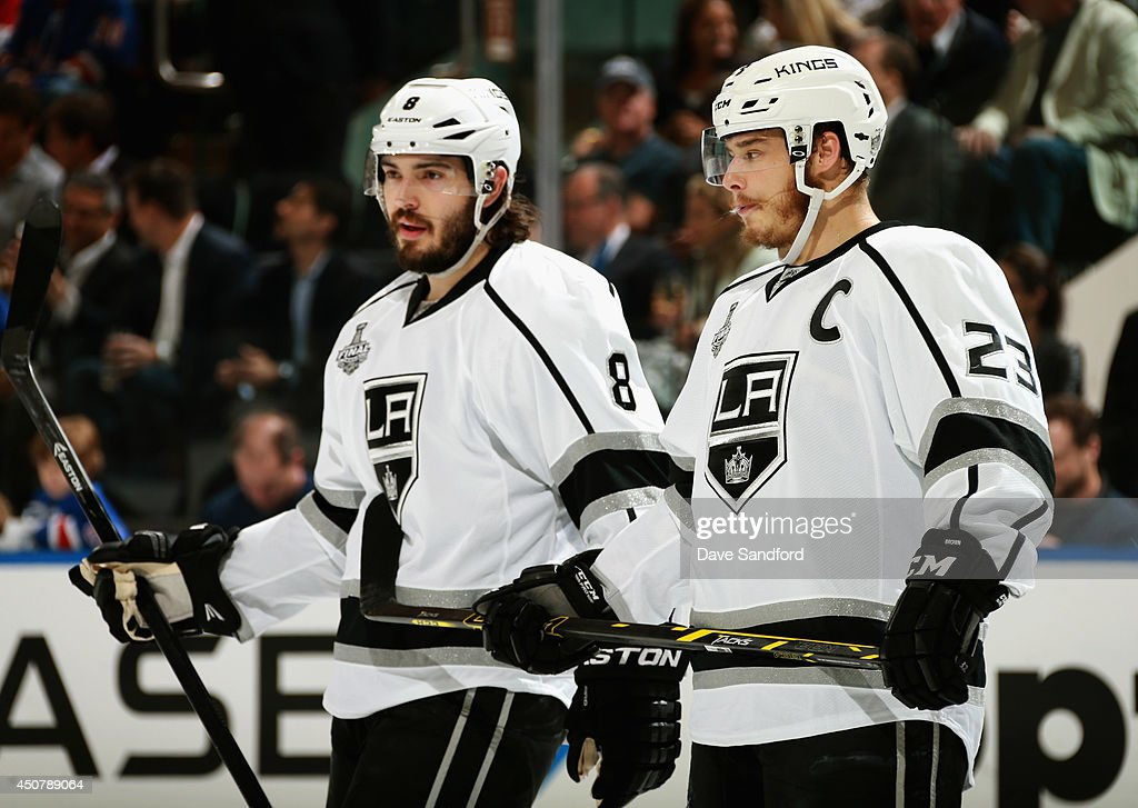 Dustin Brown #23 and <a gi-track='captionPersonalityLinkClicked' href=/galleries/search?phrase=Drew+Doughty&family=editorial&specificpeople=2085761 ng-click='$event.stopPropagation()'>Drew Doughty</a> #8 of the Los Angeles Kings play against the New York Rangers in the first period of Game Four of the 2014 Stanley Cup Final at Madison Square Garden on June 11, 2014 in New York City.