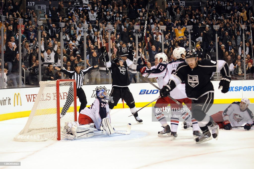Dustin Brown #23 and <a gi-track='captionPersonalityLinkClicked' href=/galleries/search?phrase=Drew+Doughty&family=editorial&specificpeople=2085761 ng-click='$event.stopPropagation()'>Drew Doughty</a> #8 of the Los Angeles Kings react after the game winning goal with less than a second remaining in regulation against <a gi-track='captionPersonalityLinkClicked' href=/galleries/search?phrase=Curtis+Sanford&family=editorial&specificpeople=213873 ng-click='$event.stopPropagation()'>Curtis Sanford</a> #30 of the Columbus Blue Jackets at Staples Center on February 1, 2012 in Los Angeles, California.