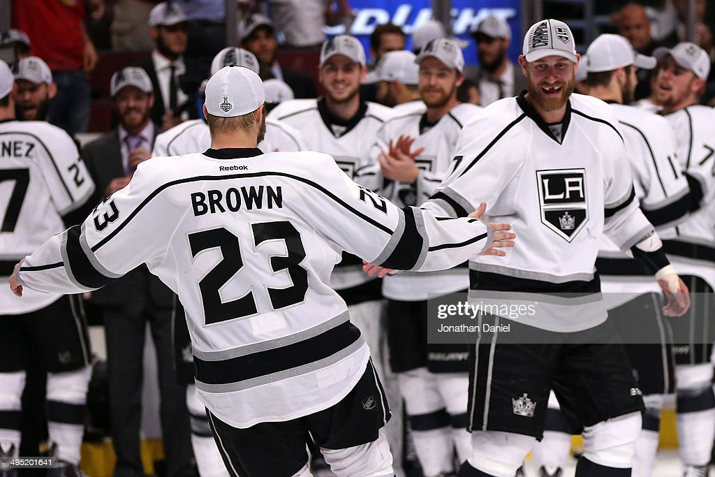 Dustin Brown #23 and <a gi-track='captionPersonalityLinkClicked' href=/galleries/search?phrase=Jeff+Carter&family=editorial&specificpeople=227320 ng-click='$event.stopPropagation()'>Jeff Carter</a> #77 of the Los Angeles Kings celebrate defeating the Chicago Blackhawks 5 to 4 in overtime in Game Seven to win the Western Conference Final in the 2014 Stanley Cup Playoffs at United Center on June 1, 2014 in Chicago, Illinois.