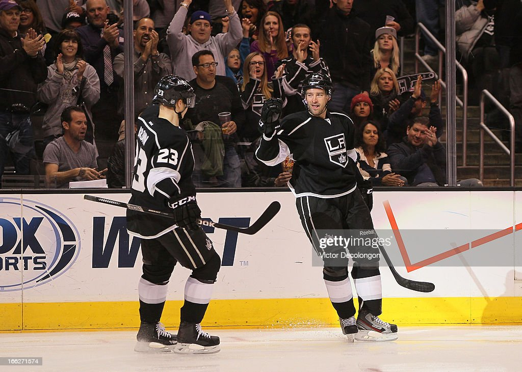 Dustin Brown #23 and Justin Williams #14 of the Los Angeles Kings celebrate Williams' second goal of the game during the second period of their NHL game against the Minnesota Wild at Staples Center on April 4, 2013 in Los Angeles, California.