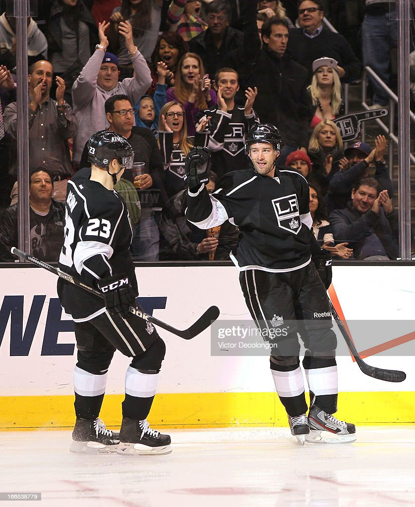 Dustin Brown #23 and Justin Williams #14 of the Los Angeles Kings celebrate Williams' second goal of the game during the second period of their NHL game against the Minnesota Wild at Staples Center on April 4, 2013 in Los Angeles, California. The Kings defeated the Wild 3-0.