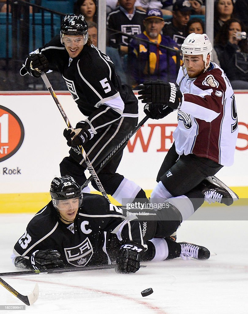 Dustin Brown #23 and <a gi-track='captionPersonalityLinkClicked' href=/galleries/search?phrase=Keaton+Ellerby&family=editorial&specificpeople=4111546 ng-click='$event.stopPropagation()'>Keaton Ellerby</a> #5 of the Los Angeles Kings and <a gi-track='captionPersonalityLinkClicked' href=/galleries/search?phrase=Ryan+O%27Reilly&family=editorial&specificpeople=4754037 ng-click='$event.stopPropagation()'>Ryan O'Reilly</a> #90 of the Colorado Avalanche chase after the puck during their preseason game at the MGM Grand Garden Arena on September 28, 2013 in Las Vegas, Nevada. Colorado won 3-2.