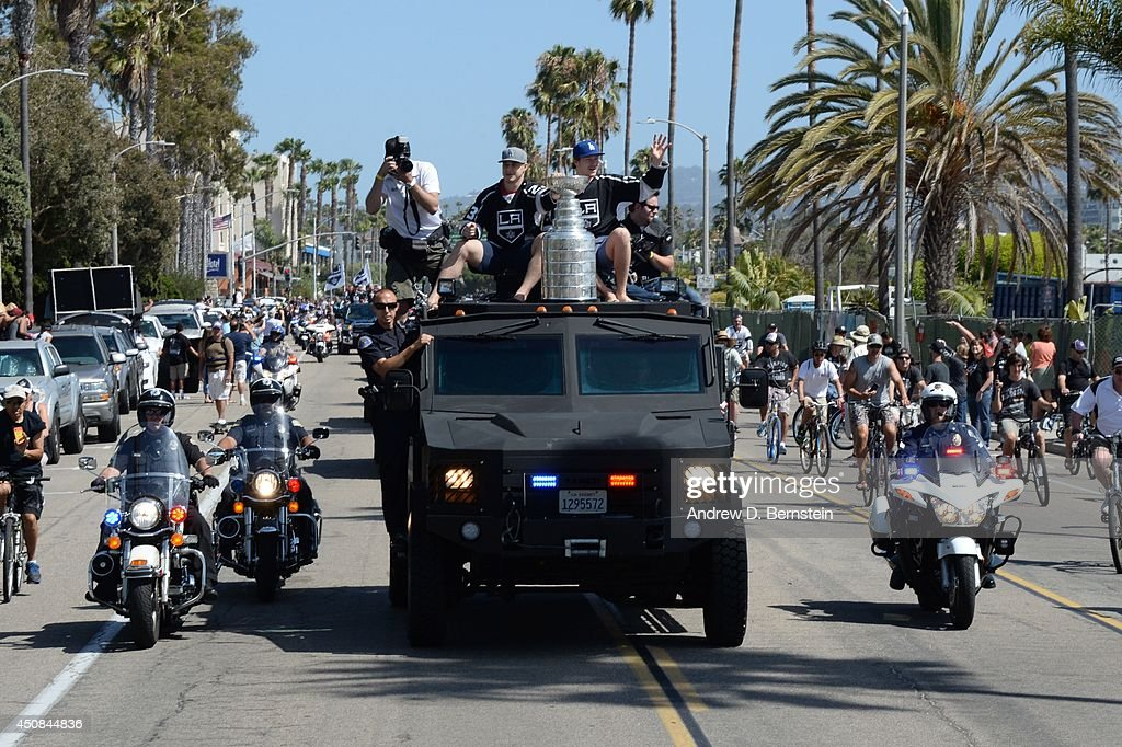 Dustin Brown #23 and <a gi-track='captionPersonalityLinkClicked' href=/galleries/search?phrase=Tyler+Toffoli&family=editorial&specificpeople=6514151 ng-click='$event.stopPropagation()'>Tyler Toffoli</a> #73 of the Los Angeles Kings sit on a truck with the Stanley Cup during the Los Angeles Kings South Bay Victory Parade on June 18, 2014 in Redondo Beach, California.