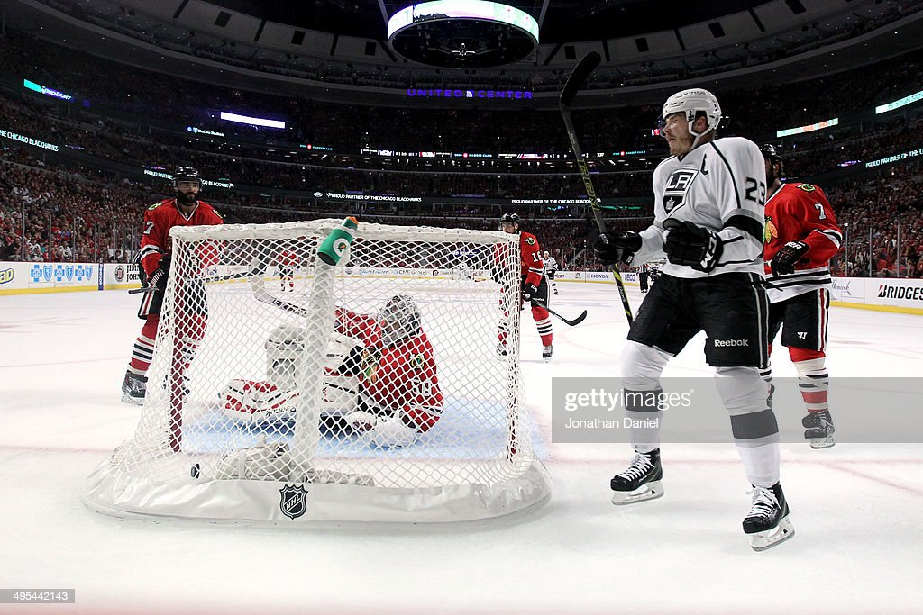 Dustin Brown #23 celebrates after <a gi-track='captionPersonalityLinkClicked' href=/galleries/search?phrase=Corey+Crawford&family=editorial&specificpeople=818935 ng-click='$event.stopPropagation()'>Corey Crawford</a> #50 of the Chicago Blackhawks gave up a goal to Justin Williams #14 of the Los Angeles Kings in the first period during Game Seven of the Western Conference Final in the 2014 Stanley Cup Playoffs at United Center on June 1, 2014 in Chicago, Illinois.