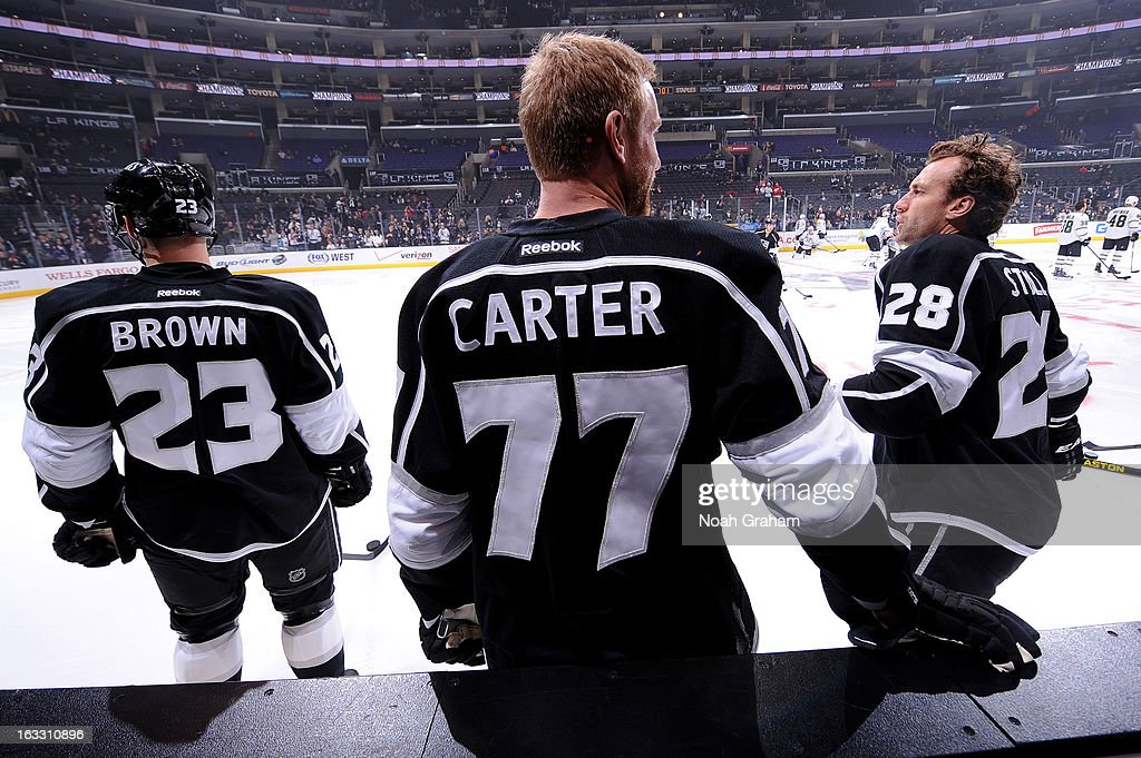 Dustin Brown #23, Jeff Carter #77 and Jarret Stoll #28 of the Los Angeles Kings warm up prior to the game against the Dallas Stars at Staples Center on March 7, 2013 in Los Angeles, California.