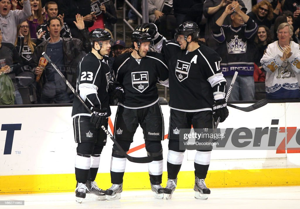 Dustin Brown #23, Justin Williams #14 and <a gi-track='captionPersonalityLinkClicked' href=/galleries/search?phrase=Anze+Kopitar&family=editorial&specificpeople=634911 ng-click='$event.stopPropagation()'>Anze Kopitar</a> #11 of the Los Angeles Kings celebrate Williams' second goal of the game during the second period of their NHL game against the Minnesota Wild at Staples Center on April 4, 2013 in Los Angeles, California.
