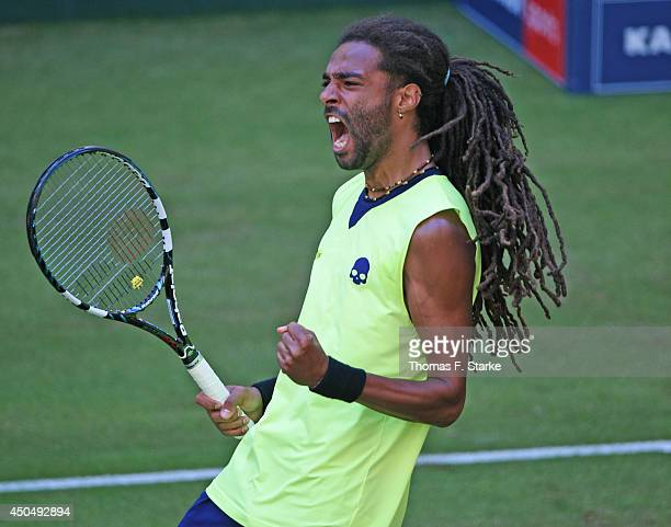 Dustin Brown of Germany celebrates in his match against Rafael Nadal of Spain during day four of the Gerry Weber Open at Gerry Weber Stadium on June...
