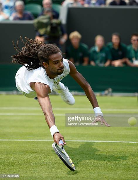 Dustin Brown of Germany dives to return a shot during his Gentlemen's Singles second round match against Lleyton Hewitt of Australia on day three of...