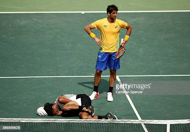Dustin Brown of Germany hurts his ankle during his match against Thomaz Bellucci of Brazil in their first round match on Day 2 of the Rio 2016...