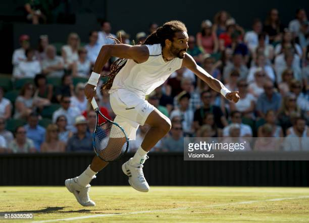 Dustin Brown of Germany in action against Andy Murray of Great Britain on day three of the Wimbledon Lawn Tennis Championships at the All England...