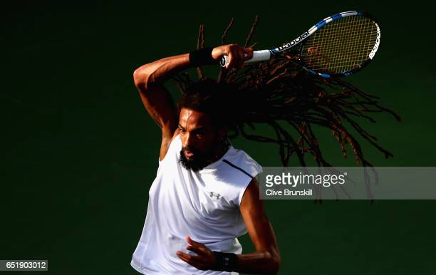 Dustin Brown of Germany in action against Dan Evans of Great Britain in their first round match during day five of the BNP Paribas Open at Indian...