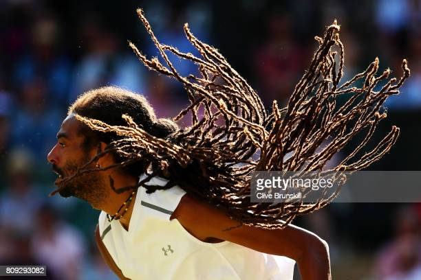 Dustin Brown of Germany in action during the Gentlemen's Singles second round match against Andy Murray of Great Britain on day three of the...