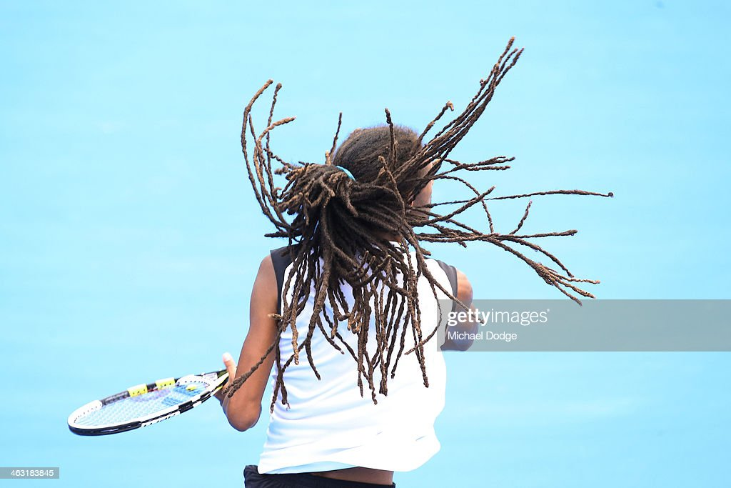 <a gi-track='captionPersonalityLinkClicked' href=/galleries/search?phrase=Dustin+Brown+-+Tennis+Player&family=editorial&specificpeople=7062090 ng-click='$event.stopPropagation()'>Dustin Brown</a> of Germany in action in his first round doubles match with Gael Monfils of France against Pablo Carreno Busta of Spain and Guillermo Garcia-Lopez of Spain during day five of the 2014 Australian Open at Melbourne Park on January 17, 2014 in Melbourne, Australia.