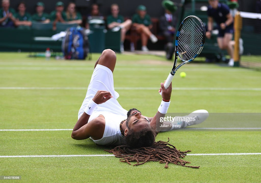 Dustin Brown of Germany lies on the floor after playing a shot during the Men's Singles second round match against Nick Kyrgios of Australia on day five of the Wimbledon Lawn Tennis Championships at the All England Lawn Tennis and Croquet Club on July 1, 2016 in London, England.