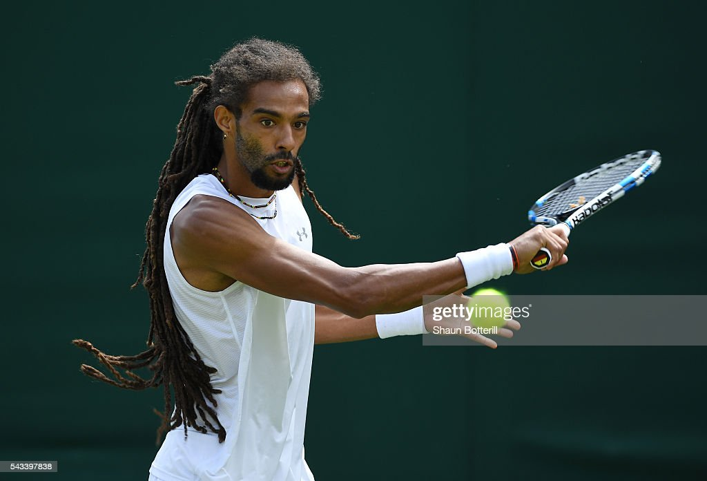 <a gi-track='captionPersonalityLinkClicked' href=/galleries/search?phrase=Dustin+Brown+-+Tennis+Player&family=editorial&specificpeople=7062090 ng-click='$event.stopPropagation()'>Dustin Brown</a> of Germany plays a backhand during the Men's Singles first round match against Dusan Lajovic of Serbia on day two of the Wimbledon Lawn Tennis Championships at the All England Lawn Tennis and Croquet Club on June 28, 2016 in London, England.