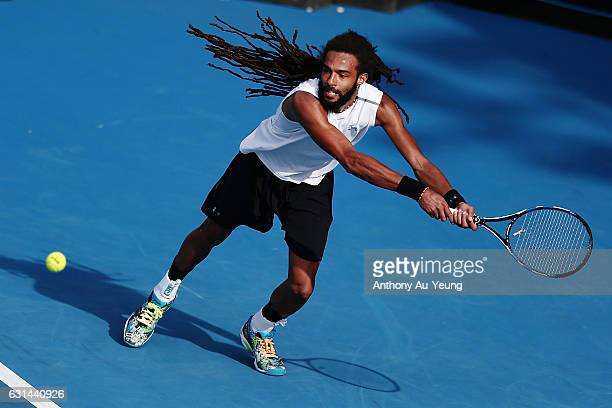 Dustin Brown of Germany plays a backhand in his match against Marcos Baghdatis of Cyprus on day ten of the ASB Classic on January 11 2017 in Auckland...