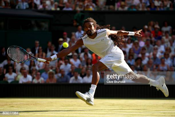 Dustin Brown of Germany plays a forehand during the Gentlemen's Singles second round match against Andy Murray of Great Britain on day three of the...