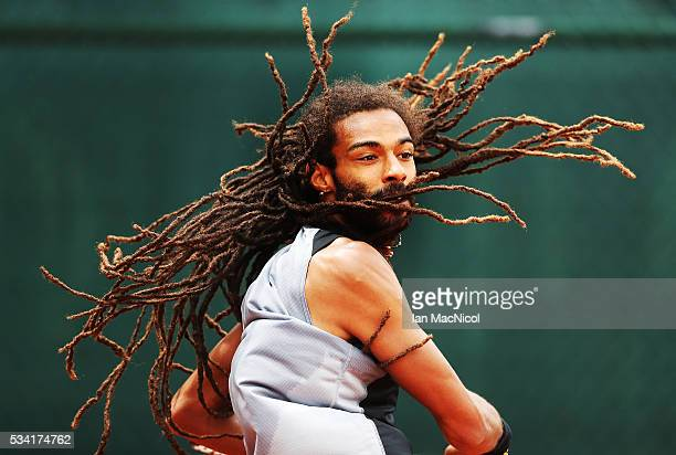 Dustin Brown of Germany plays a shot during the Men's Singles Second Round match against Jack Sock of United States on Day Four of the 2016 French...