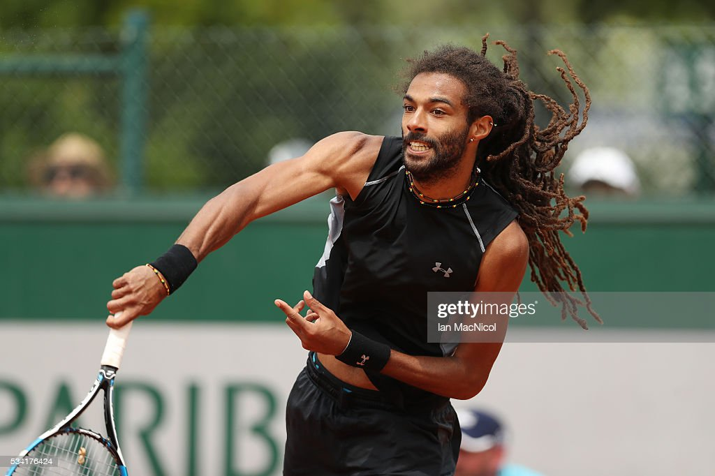 <a gi-track='captionPersonalityLinkClicked' href=/galleries/search?phrase=Dustin+Brown+-+Tennis&family=editorial&specificpeople=7062090 ng-click='$event.stopPropagation()'>Dustin Brown</a> of Germany plays a shot during the Men's Singles Second Round match against Jack Sock of United States on Day Four of the 2016 French Open at Roland Garros on May 25, 2016 in Paris, France .