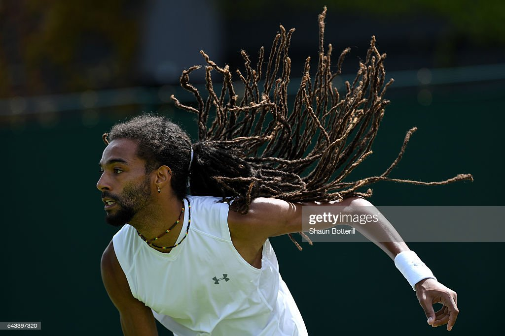 <a gi-track='captionPersonalityLinkClicked' href=/galleries/search?phrase=Dustin+Brown+-+Tennis+Player&family=editorial&specificpeople=7062090 ng-click='$event.stopPropagation()'>Dustin Brown</a> of Germany reacts during the Men's Singles first round match against Dusan Lajovic of Serbia on day two of the Wimbledon Lawn Tennis Championships at the All England Lawn Tennis and Croquet Club on June 28, 2016 in London, England.