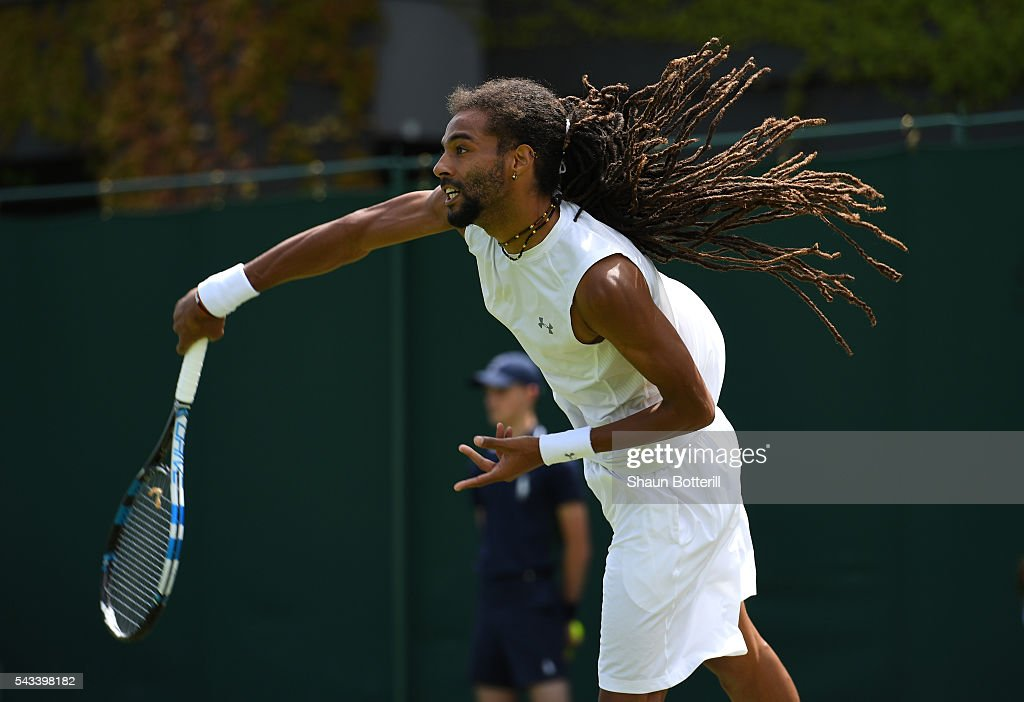 <a gi-track='captionPersonalityLinkClicked' href=/galleries/search?phrase=Dustin+Brown+-+Tennis+Player&family=editorial&specificpeople=7062090 ng-click='$event.stopPropagation()'>Dustin Brown</a> of Germany serves during the Men's Singles first round match against Dusan Lajovic of Serbia on day two of the Wimbledon Lawn Tennis Championships at the All England Lawn Tennis and Croquet Club on June 28, 2016 in London, England.