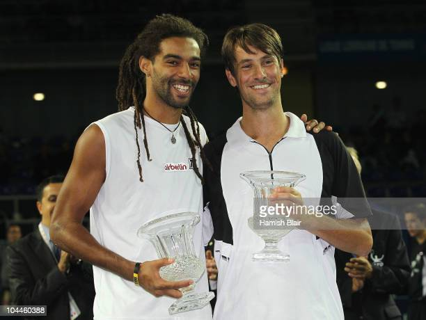 Dustin Brown of Jamaica and team mate Rogier Wassen of Netherlands celebrate with their trophies after the victory in the doubles final against...