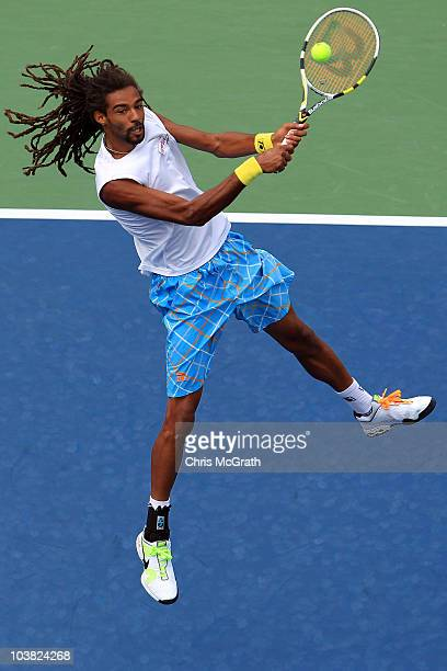 Dustin Brown of Jamaica returns a shot against Andy Murray of Great Britain during his men's singles match on day five of the 2010 US Open at the...